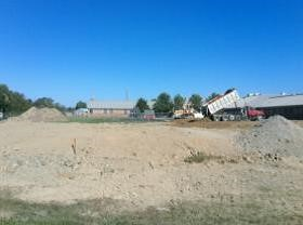 Elementary building pad being completed; stake is building corner